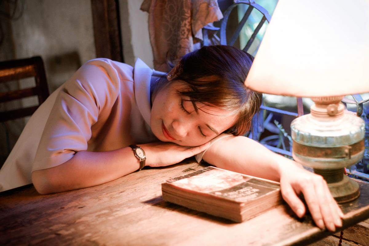 girl sleeping at desk